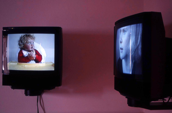 Video Installation Shot, Mother and child face each other on two separate monitors as a formal consideration